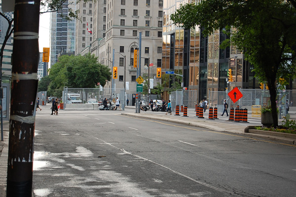 This is one of the busiest streets in Toronto, it is where a huge majority of traffic and people filter through. This stretch is usually a sea of yellow taxis, business people, tourist and sketchy characters. It is very quite on this day except for police barking and sirens.